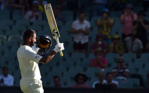 India's batsman Cheteshwar Pujara celebrates his century against Australia during day one of the first cricket Test match at the Adelaide Oval.