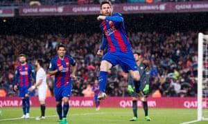 Lionel Messi celebrates after scoring Barcelona's third goal.