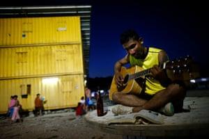 Laotian migrant worker Hasadee Sriphrajun plays the guitar
