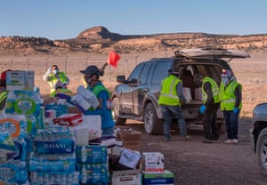 Native Americans of the Navajo Nation people, pick up supplies from a food bank set up at the Navajo Nation town of Casamero Lake in New Mexico on 20 May.