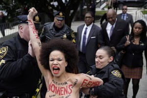 A protester is subdued by the police after breaking through the barriers, as actor and comedian Bill Cosby arrived for the first day of his sexual assault retrial at the Montgomery county courthouse.