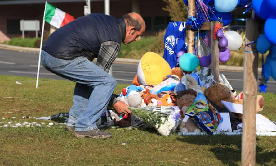 A man leaves some flowers outside Alder Hey Children's hospital in Liverpool, following the death on Saturday morning of 23-month-old Alfie Evans.
