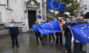 Pro-EU demonstrators gather outside the Royal Courts of Justice in London.