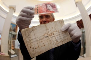 John Keyworth, curator at the Bank of England Museum, with the current £50 note and its earliest surviving predecessor from 1732