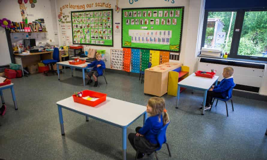Pupils in the new classroom layouts as they return to their first day back of school at Williamstown Primary School, South Wales in June 2020.