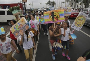 Campaigners in Manila, Philippines, march through the city
