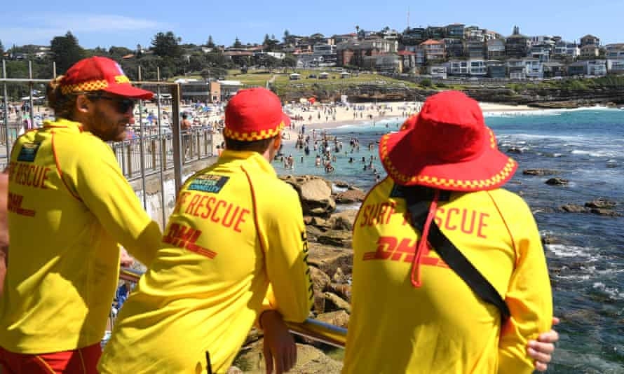 Surf Lifesavers watch beachgoers at Bronte beach, in Sydney, on Saturday.