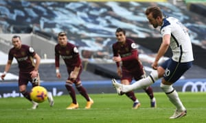 Tottenham Hotspur's English striker Harry Kane scores a penalty.