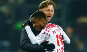 Leipzig coach Ralph Hasenhuettl celebrates with Ademola Lookman after the match.