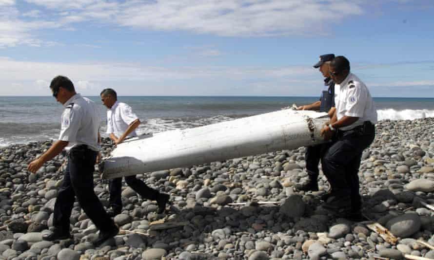 Officers carry debris in Saint-Andre de la Reunion, eastern La Reunion island, France in 2015.