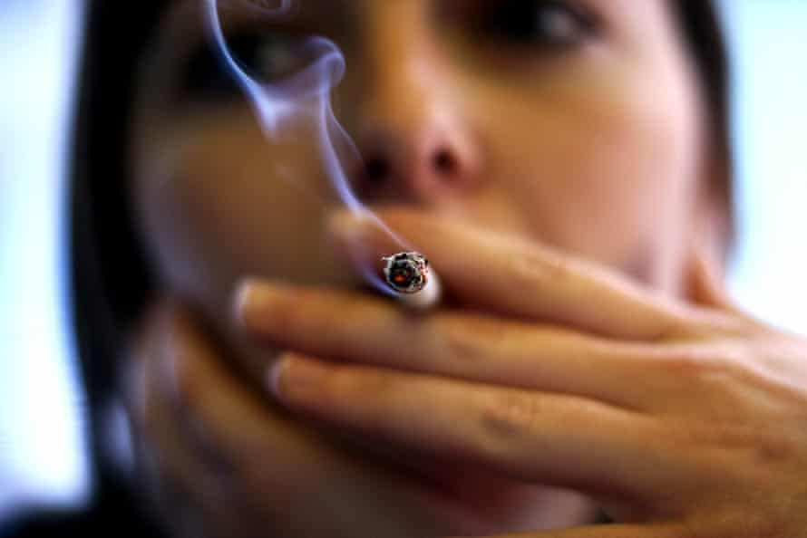 A woman smokes in Spain