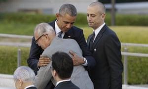 Barack Obama embraces survivor Shigeaki Mori.