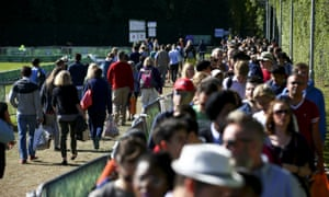 Spectators queue to get into the ground on Sunday.