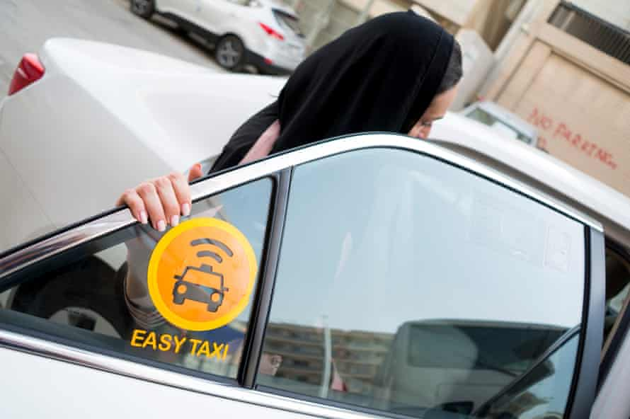 Women getting into an Easy Taxi