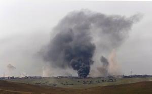 Mosul, Iraq Smoke is seen as members of the Iraqi army clash