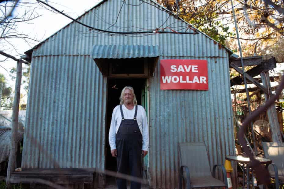 Col Faulker, 68, over 40-year resident of Wollar, NSW standing at the entrance of his home. A town now predomintaly owned by American coal-mining company Peabody.