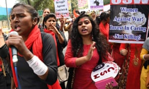 Indian women shout slogans at a march to mark International Women's Day in New Delhi, 2019.