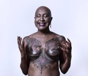 Juanita with a tattoo over both breasts
