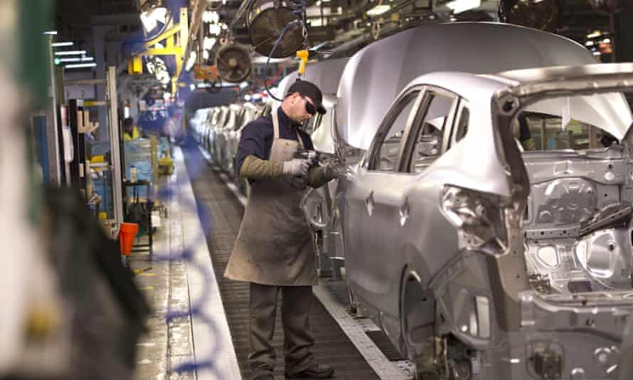 An employee works on the Nissan assembly line at Sunderland