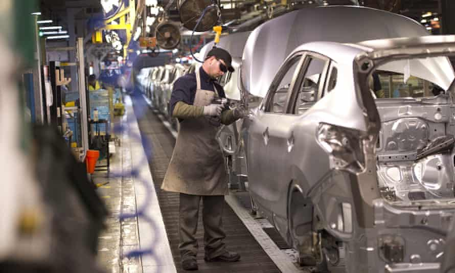 A member of Nissan's manufacturing staff at work in the Sunderland plant.
