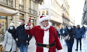 A Santa Claus on Sunday in Turin, Italy