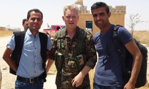Michael Enright, centre, a British actor who has had minor roles in Hollywood films, wears the Kurdish People's Protection Units military uniform.
