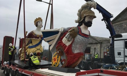 The Windsor Castle and Defiance figureheads in transit.