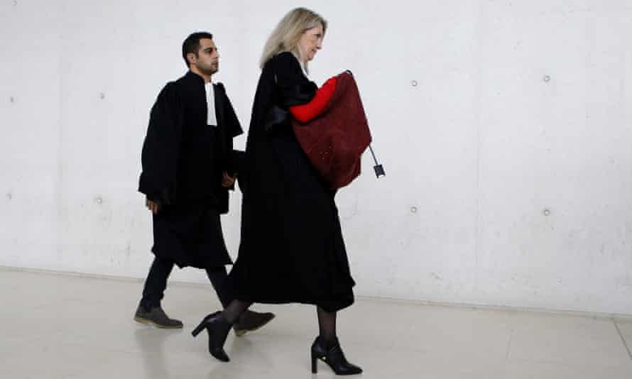 The suspect's lawyers Marc Goudarzian and Sandrine Parise-Heideiger arrive at court in north-west Paris.
