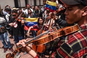 Musicians perform during a demonstration in support of Venezuelan opposition leader and self-declared acting president Juan Guaidó, outside Colombia's foreign ministry in Bogotá on 25 February 2019