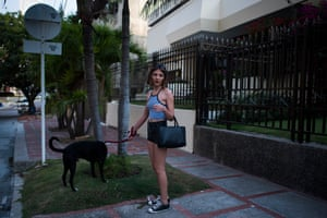 Effy takes one of her dogs for a walk near her house