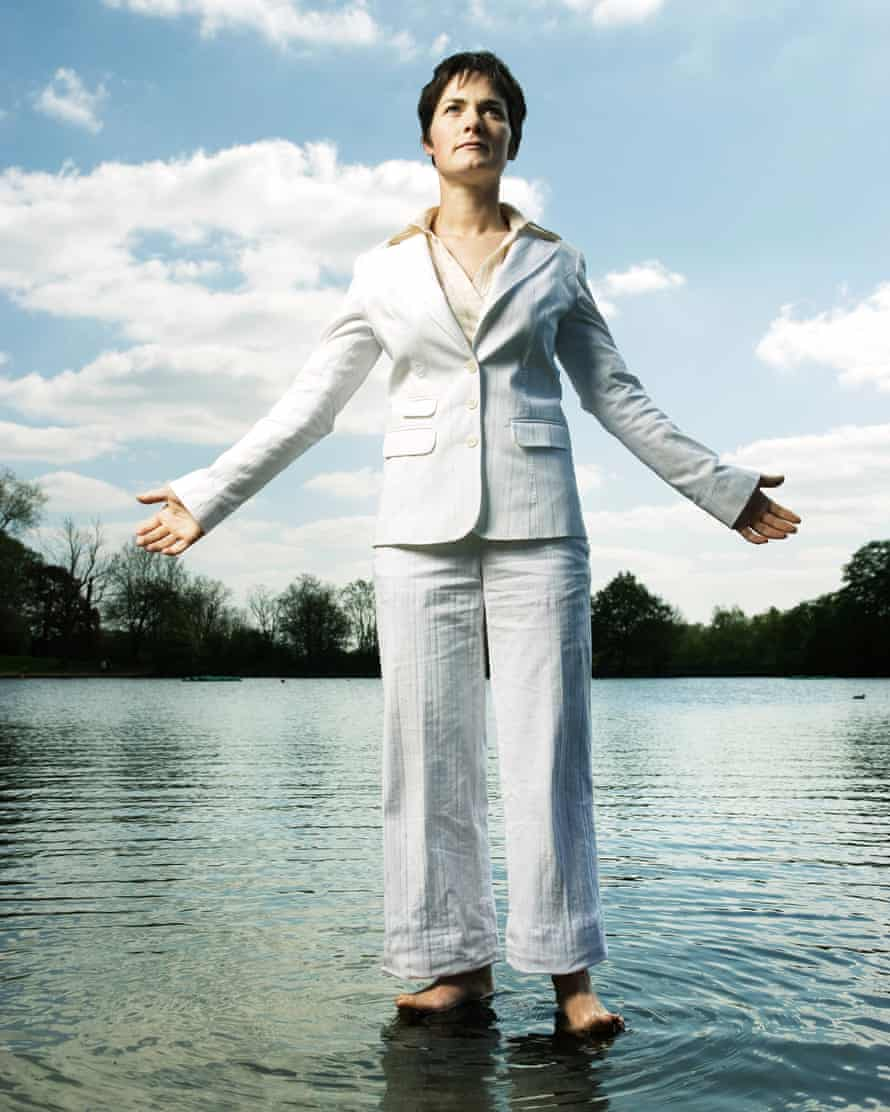 Dame Ellen MacArthur, in a white suit standing in a pond on Hampstead Heath.
