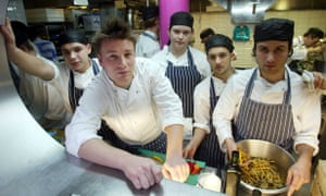 Jamie Oliver with some of his apprentices at Fifteen restaurant in central London.