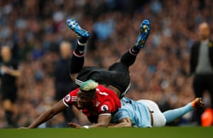 Manchester United's Paul Pogba is floored byManchester City's Danilo.