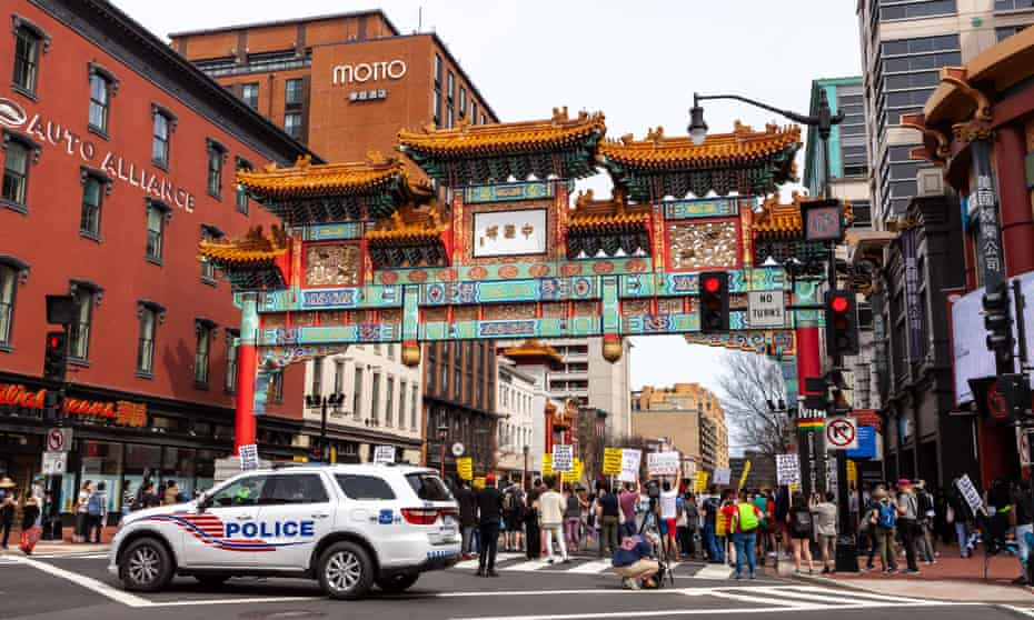 Protesters attend a day of action against Anti-Asian violence at the Chinatown Gate in downtown Washington on 27 March.