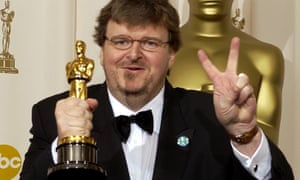 'The idea that we could go two years in a row, where 40 actors could be nominated and none of them were black, is just crazy' ... Michael Moore with his statuette at the 2003 Oscars.