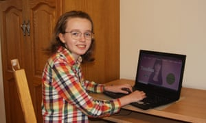 Fíona Geary at her computer at home
