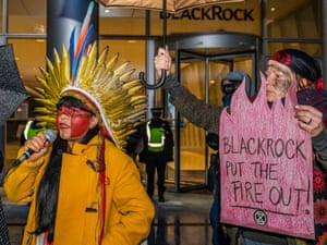 Brazilian Indigenous activist Luana Tapajós outside BlackRock's London headquarters last November.