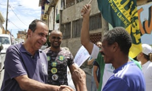 Alexandre Kalil, a former football club president, greets people on the campaign trail in Belo Horizonte.
