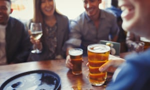 Adults drinking beer and wine