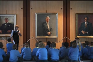 Parliament House guide Gina Hall shows schoolchildren from the Lake Joondalup Baptist College the Bob Hawke official portrait