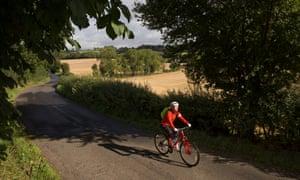 Helen Pidd cycling through countryside near Hadrian's Wall