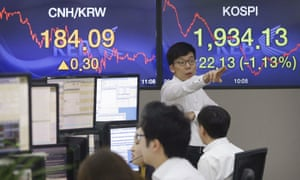 A currency trader at the foreign exchange dealing room of the Korea Exchange Bank headquarters in Seoul, South Korea, on Wednesday.