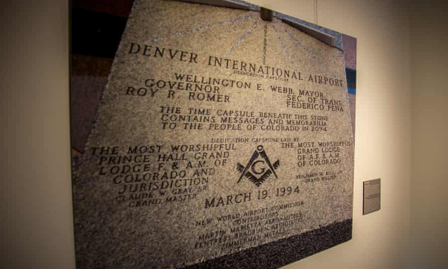 A photo of the dedication stone at Denver International Airport, featured in an exhibition about conspiracy theories related to the airport