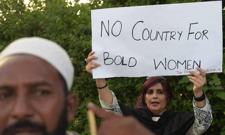 An activist protests following the murder of social media celebrity Qandeel Baloch by her brother in 2016