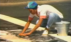 Jolene King scrubs a Carinda road in the clip for Let's Dance, filmed in the small NSW town in 1983