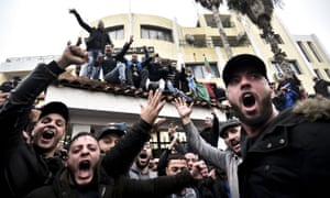 Protesters chant slogans during a rally in the city of Tizi Ouzou