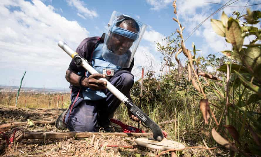 A member of a clearance team uses a metal detector to check for unexploded mines in the Angolan province once visited by Princess Diana