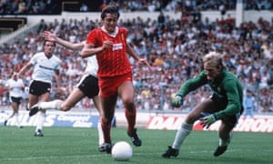 Liverpool's Michael Robinson attempts to beat Manchester United's Gary Bailey during the 1983 Charity Shield at Wembley.