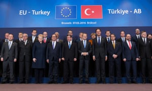 Turkish Prime Minister Ahmet Davutoglu poses with European Union leaders during a EU-Turkey summit in Brussels.