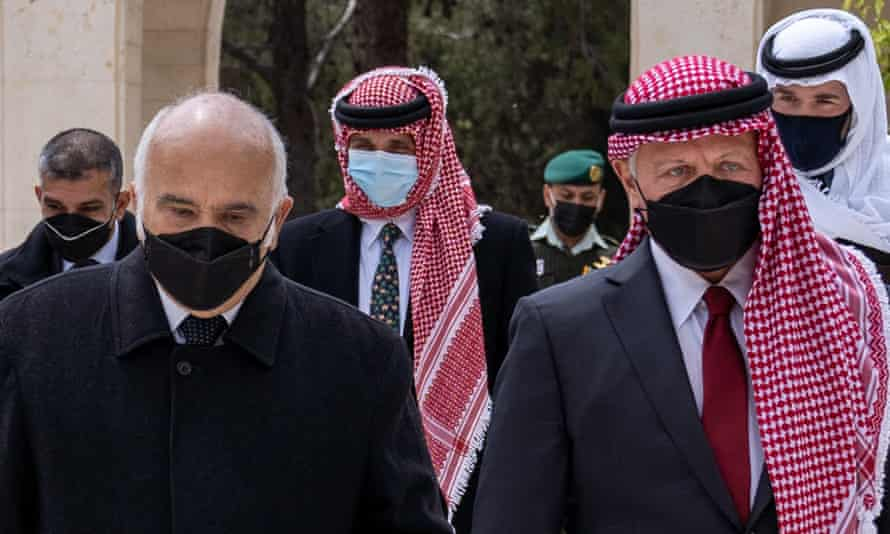 Prince Hamzah, centre, pictured behind Prince Hassan Bin Talal, left, and King Abdullah II, right, at the Raghadan palace in Jordan.